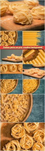 The dry Italian pasta on gray wooden background