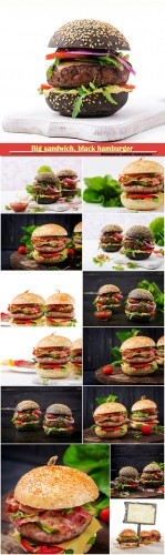 Big sandwich, black hamburger with juicy beef burger, cheese, tomato,  and red onion on black background